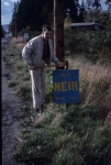 Chuck Fleming's dad posting a Neir campaign sign (circa 1970) in Houghton.